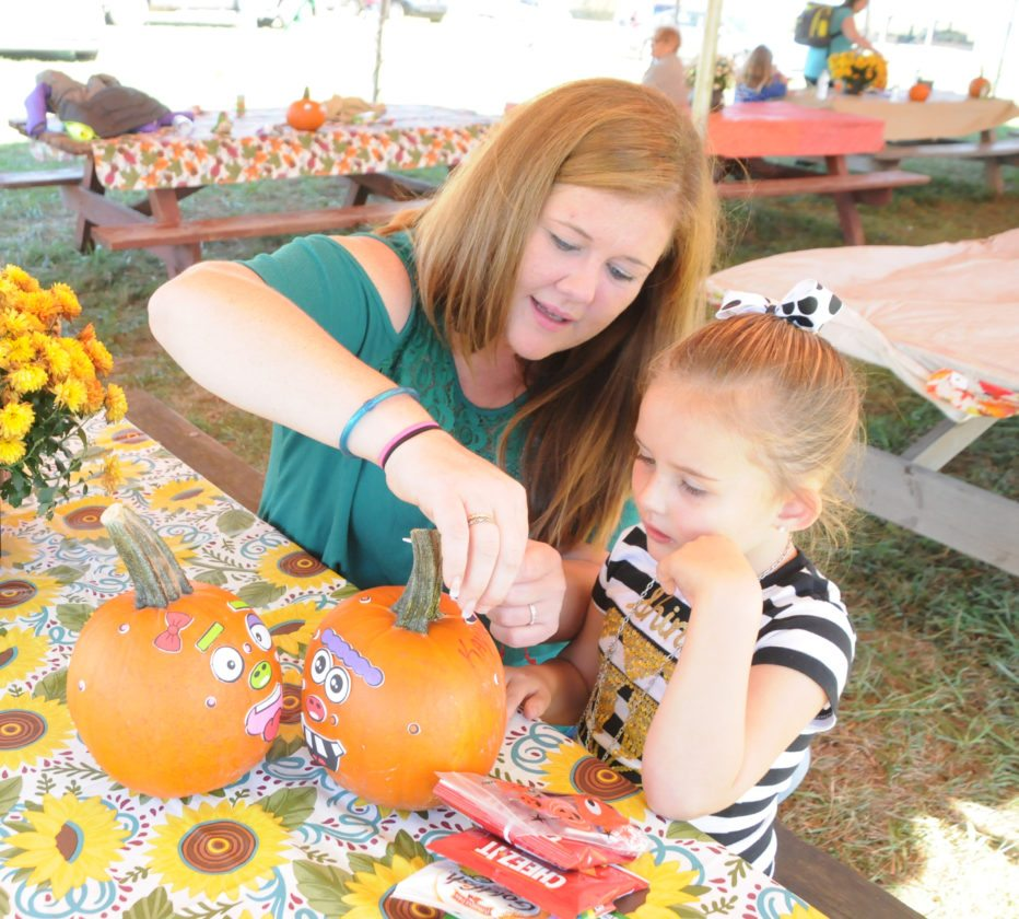 "The Inter-Mountain photo by Beth Henry-Vance Kaytlann Richards, a preschool student from George Ward Elementary School, decorates pumpkins Friday with help from her mother, Jessica Sampson. All Randolph County preschoolers were invited to the Randolph County Fair Corn Maze & Pumpkin Patch near Beverly as part of a fall field trip sponsored by North Central West Virginia Head Start.   By Tim MacVean Senior Staff Writer  ELKINS – The Elkins City Council received an annual report from the Randolph County Humane Society during their meeting this week. Tina Hord Vial, president of the board of directors for the RCHS, described this year as ""challenging,"" citing an incident where the facility took in their second largest seizure case in its history. ""(The seizure) challenged our resources, our volunteers and our staff,"" she said. ""As we approach the final resolution for all 32 dogs and one cat; however, we can't begin to express how supported we've felt by the community."" Vial said the RCHS received a great deal of support once news broke of the seizure. ""The outpouring of supplies, donations, time and encouragement has been nothing short of phenomenal, without which we don't know how we would have made it through,"" Vial said. To date, the RCHS has taken in 461 kittens, cats, puppies and dogs. ""This total number is down slightly from previous years but three months with the large legal case limited our ability to take in additional animals,"" Vial said. Vial said the shelter is looking into a microchipping program that would more easily reunite lost pets with their owners. ""We know that one of the most effective methods of reuniting lost pets with their families is through microchipping,"" she said. ""We are looking into launching a microchipping effort to help ensure more Randolph County pets are chipped so we can get them back home faster."" The facility has also continued their ""Compassion in Action"" program, which has allowed them to assist 27 families with financial hardship by providing 300 pounds of cat food and 700 pounds of dog food, enabled them to provide 28 families with a total of 49 bales of straw for outdoor pets during extreme winter weather and allowed them to provide spay and neuter services to 77 families with 189 pets. ""We try to focus (the spay and neuter services) on hard-to-adopt breeds in order to reduce the number of puppies produced in unplanned litters,"" Vial said. ""Our largest population are pit bulls and we can't transport them because there are already so many of them in other destination states. We just don't have options for them so we do our best to try to reduce that population by providing spay and neuter services."" Vial explained that fundraising is crucial to maintaining the shelter because their budget is $262,000 per year for operation expenses, veterinary costs, medical supplies, payroll and transports. They receive $80,000 from the Randolph County Commission as part of a partnership for stray, abused, neglected and legal case animals within the county. The remainder of the budget is funded by donors from individuals or local businesses, grants and fundraising. In 2016, RCHS raised money through the Mountain State Forest Festival, Spay-ghetti Dinner, Ramps and Rail Festival, Woofstock, Wine, Spirits and Whiskers, Tails and Ales, Smoke on the Water Furry Friends Fundraiser, Uncle Sam's Pet Parade, and Treasure on the Mountain ticket sales. ""Fundraising is an area where we will continue to focus this year,"" Vial said. For more information on the facility, to make a donation or to volunteer, contact the facility at 304-636-7844 or check them out online at www.rchswv.org."