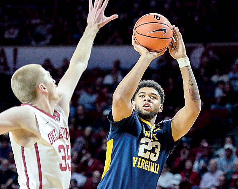 WVU holds off TCU for 82-66 win
