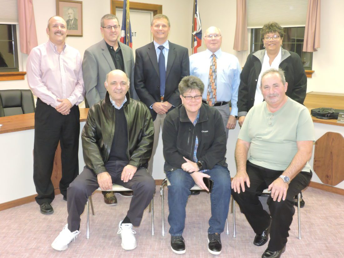 T-L Photo/ ROBERT A. DEFRANK The St. Clairsville City Council assembled. Front row, left to right: Jake Olsavsky; Beth Oprisch; Frank Sabatino. Back row, left to right: John Tomlan; Mike Smith; J. Mark Bukmir; Jim Weisgerber (president); Linda Jordan.