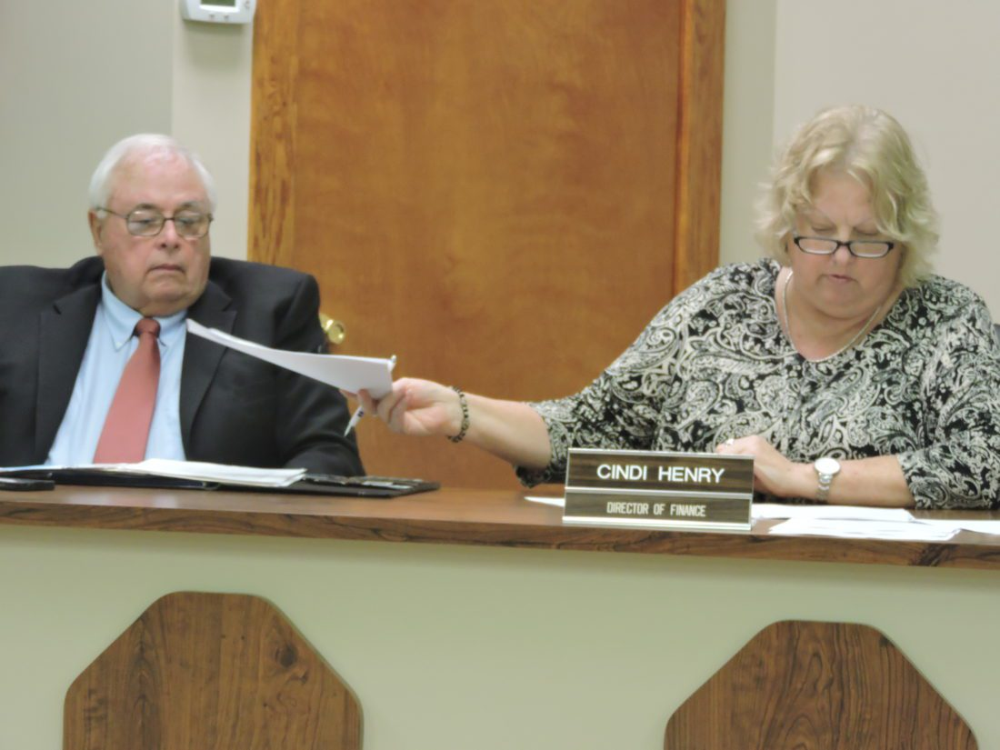 T-L Photo/ROBERT A. DeFRANK St. Clairsville Mayor Terry Pugh and Finance Director Cindi Henry discuss matters during Monday's city council meeting.