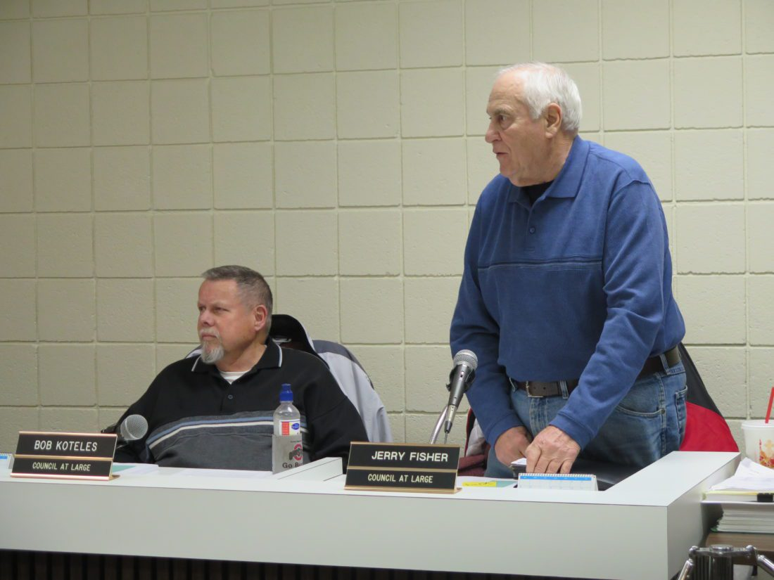 Photo by Joselyn King Bellaire Councilman Robert Koteles, left, listens as Councilman Jerry Fisher makes points before Thursday's council meeting.