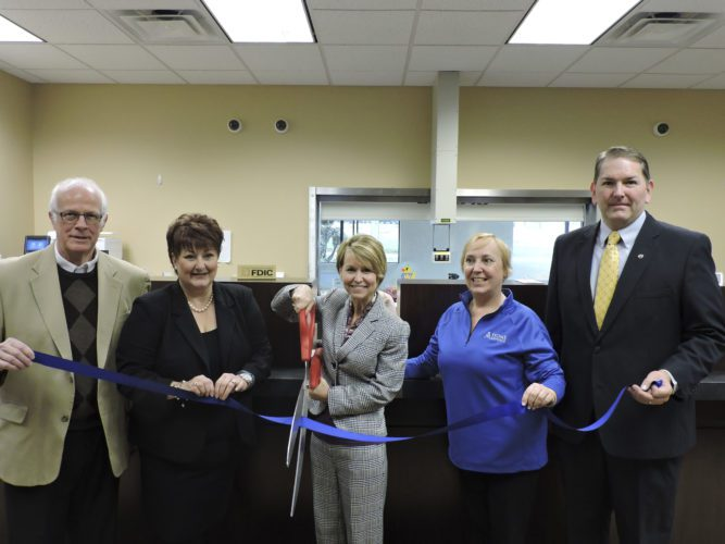 T-L Photo/DYLAN McKENZIE  Several Home Savings Bank employees and local community members cut a ribbon at the official opening of the Home Savings Bank St. Clairsville branch. From left are Dave Knuth, executive director of the Marshall County Chamber of Commerce; Wendy Anderson, executive director of the St. Clairsville Area Chamber of Commerce; Denise Penz, executive director of Wealth Management for Home Savings; Pamela McKim, branch sales manager; and Michael Taylor, commercial relationship manager.