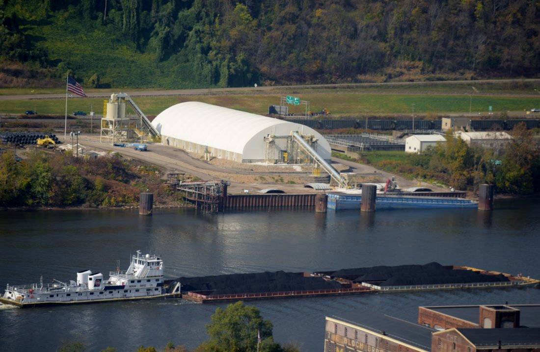 A barge passes the Bellaire Industrial Park Sand Terminal on Guernsey Street, just north of MPR and Muxie Distributing.
