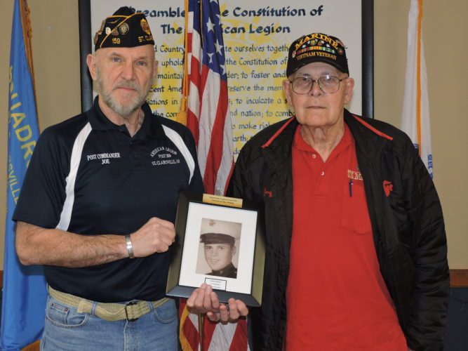 T-L Photo/ROBERT A. DEFRANK St. Clairsville American Legion Commander Joe Barker, left, recognizes helicopter pilot John Orkish as Veteran of the Month.