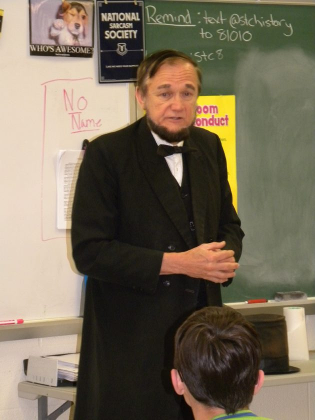 T-L Photo/RICK THORP ABRAHAM LINCOLN, portrayed by John Cooper, speaks to Sarah Steele's first-period American history class recently at St. Clairsville Middle School.