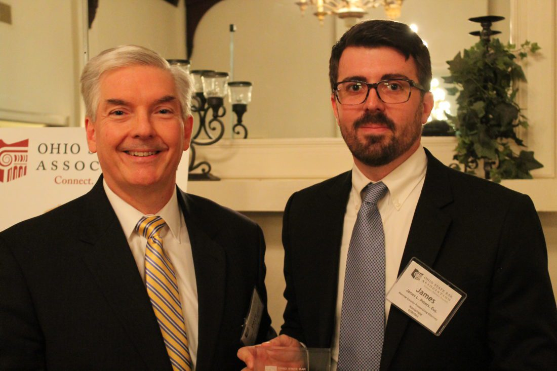 Guernsey County Probate and Juvenile Court Judge David B. Bennett congratulates Monroe County Prosecuting Attorney James L. Peters on receiving the Community Service Award from the Ohio State Bar Foundation.  Photo Provided