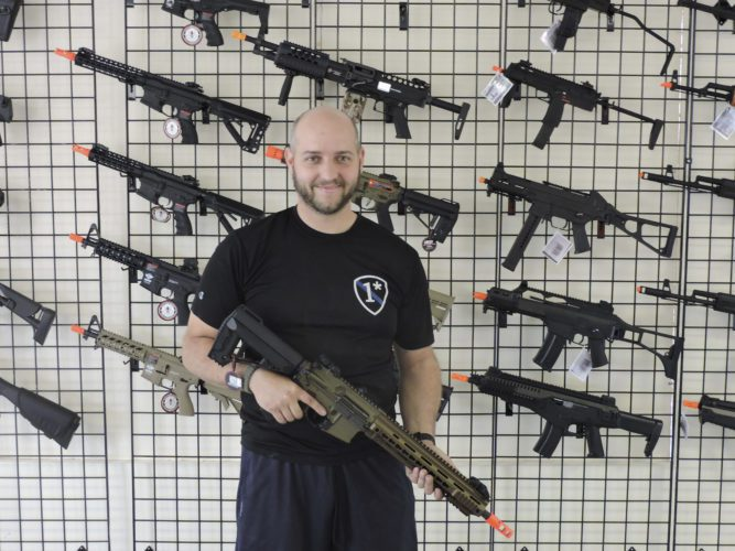 APPhoto ABOVE: Mike Wheeler poses holding one of his favorite Airsoft guns at the Ohio Valley Airsoft store. The store will offer a wide variety of top-of-the line Airsoft guns and equipment to purchase.