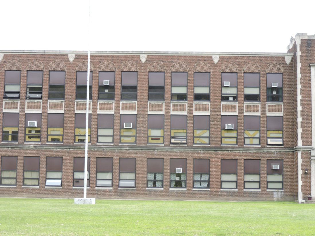 "T-L Photo/DYLAN MCKENZIE A series of letters spells out ""Team Buckeye"" in the windows of Buckeye South Elementary School."