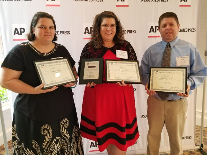 T-LPhoto/Janelle Patterson Representing The Times Leader at the Associated Press Media Editors annual Ohio banquet in Columbus Sunday are, from left, Staff Writer Shelley Hanson, Managing Editor Jennifer Compston-Strough and Sports Writer Rick Thorp. Hanson and Thorp both captured awards, as did Staff Writers Janell Hunter and Casey Junkins.