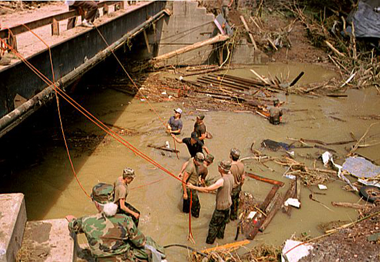 National Guard personnel assist with the cleanup from the Wegee Creek flood in 1990. After the initial disaster had passed, aid poured into the area from both in and out of state, assisting the Belmont County Emergency Management Agency and other local first responders.