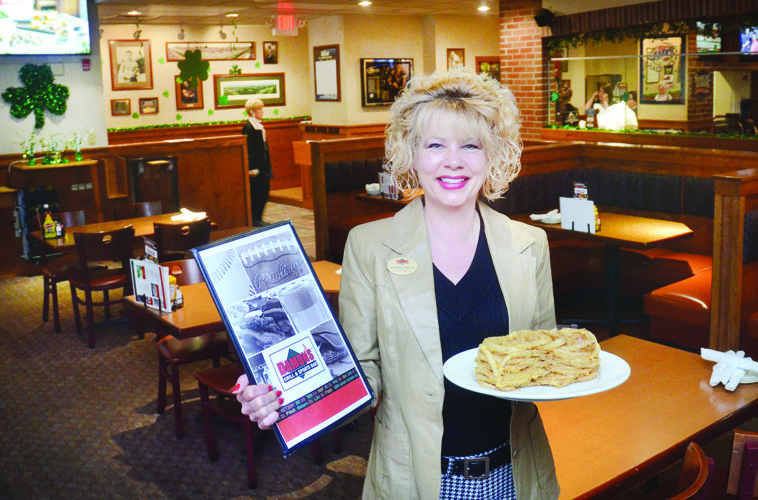 Photo by Scott McCloskey Supervisor Pamela Morris displays the always popular onion loaf offered at Damon's Restaurant.