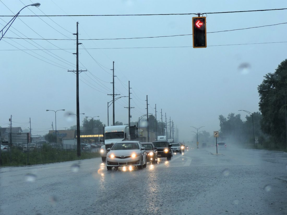 Water from heavy rain pools along Ohio 7 on Friday afternoon. The National Weather Service predicted 2-3 three inches of rain would fall on the local region, leading to flash flood watches and warnings.