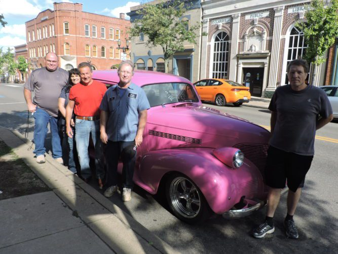 T-L Photo/ROBERT A. DEFRANK Members of the Classy Chassis Car Club, with Belmont County Common Pleas Judge Frank Fregiato and Drug Task Force Commander/Martins Ferry Police Chief John McFarland prepare for a car show to benefit the county's Staying Clean drug-free club with the goal of encouraging younger children to stay off drugs. Posing, from left, with car club member Jim McCraw's 1939 Chevrolet are McFarland, John Rico, Donna Yocum, Fregiato and McCraw.