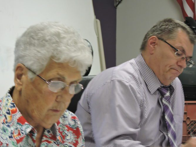 T-L Photo/ROBERT A. DEFRANK The Martins Ferry City Schools Board of Education approved the promotion of new administrators during their meeting. Board member Joe Lovell reviews information.  Ferry schools promote administrators
