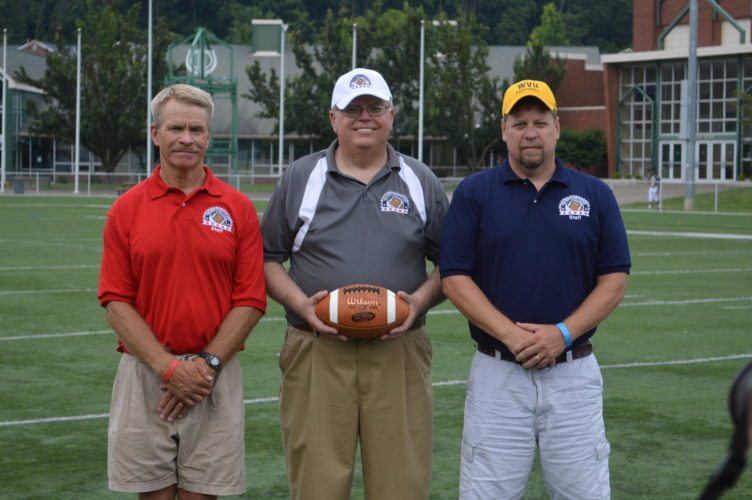 Photo/JOSH STROPE OVAC RUDY Mumley Game Director Bob Koch (center) is flanked by the two head coaches for Saturday's annual contest, which will be played at Martins Ferry's Purple Rider Stadium. Ohio's head coach is Karl Justus and leading the West Virginia squad is John Durdines (right).