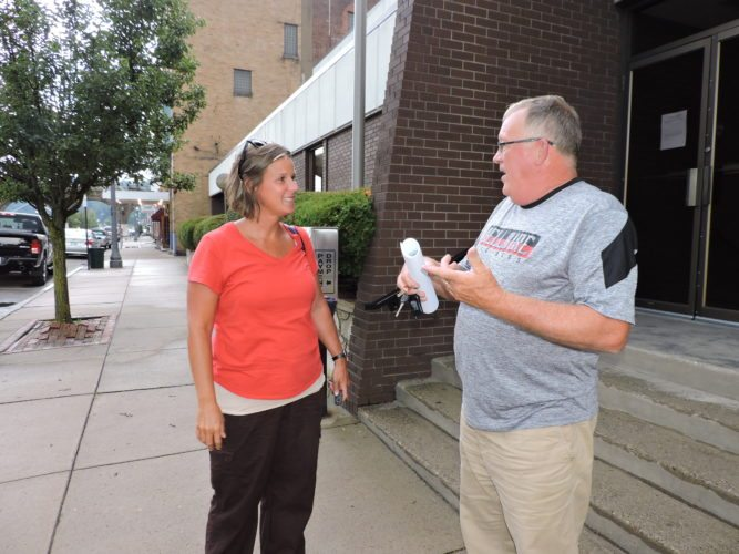 T-L Photo/SHELLEY HANSON BELLAIRE COUNCILWOMAN Nikki Liberatore, left, and Councilman Donny Maupin talk outside the municipal building after Thursday's village council meeting.