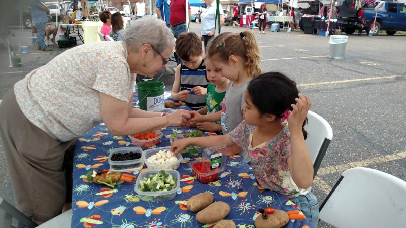 Photo Provided LOCAL CHILDREN work with adults at the Ohio Valley Farmers' Market, completing crafts, growing their own crops and learning about where their food comes from.