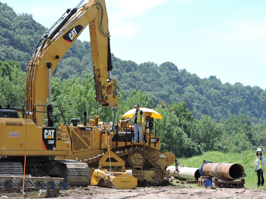 T-L Photo/Casey Junkins Contractors work at a     natural gas pipeline        operation in  Marshall County.       Work continues           on infrastructure to move   Marcellus and Utica shale  products through the Upper Ohio     Valley.