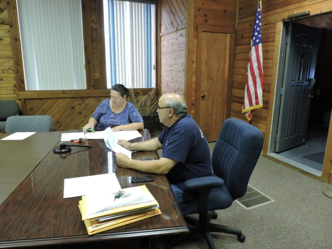 T- L Photo/JANELL HUNTER Tiltonsville Clerk/Treasurer Korrene Prince and Mayor Ty Lollini discuss with council the need for a new 1.5 mill levy to support its police department at a special council meeting Monday.