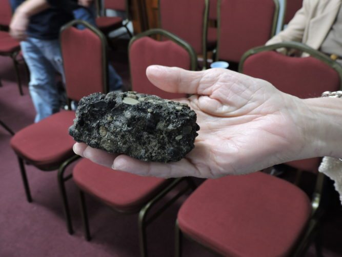 File Photo/SHELLEY HANSON/ SHOWN HERE is the chunk of concrete once brought to Martins Ferry City Council by resident Lois Suriano to illustrate the crumbling state of North Ridge Road. The road is expected to be repaved in the next couple months by Lash Paving of Martins Ferry.