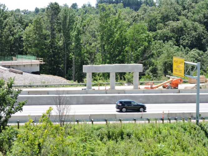 T-L Photo/DYLAN McKENZIE/  Cars travel on Interstate 70 as a bridge crossing the busy roadway takes shape. Part of the Commons Mall Crossing project, the interstate will experience closures and delays through the next few weeks aa work continues on the bridge and associated projects.