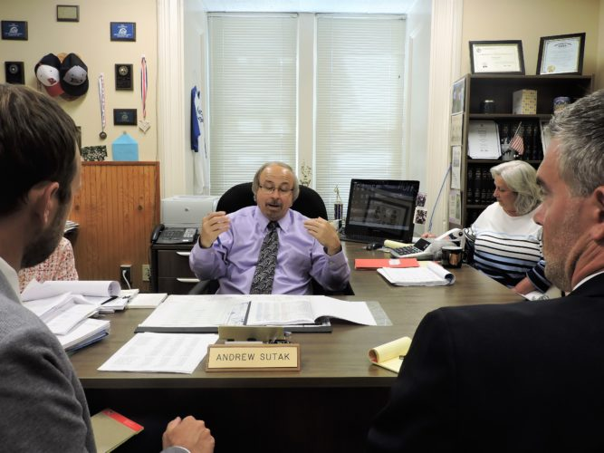 Photo by Robert DeFrank/ Belmont County Auditor Andy Sutak, center, reviews the expectations for the 2018 budget with the Belmont County Board of Commissioners. Funding is expected to be tight this coming fiscal year.