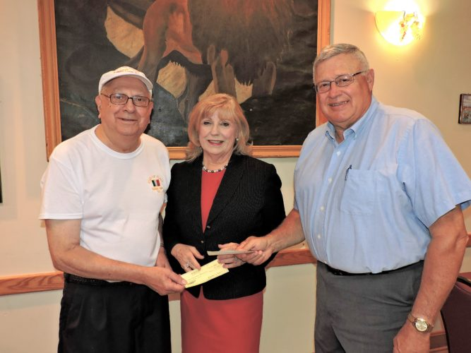 T-L Photo/SHELLEY HANSON/ SONS OF Italy of Bellaire members Phil Pata, left, and Larry Seibieda present a check for $1,000 to Helen Paes, community development coordinator with the Alzheimer's Association, for Alzheimer's disease research.