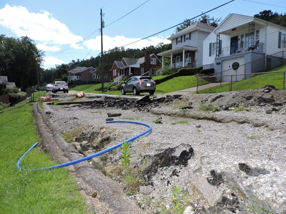 T-L Photo/SHELLEY HANSON/ A SECTION of North Eighth Street in Martins Ferry where a massive slip occurred last August remains closed this week. The job is expected to be bid out as soon as the necessary inspection of surrounding homes occurs, says Service Director Chris Cleary.