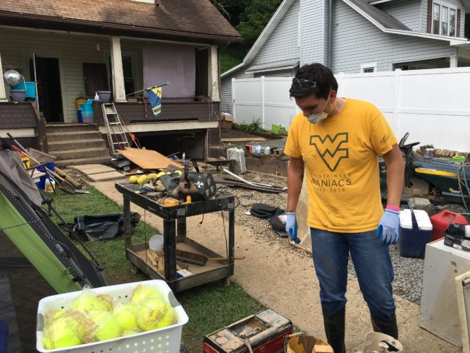 Photo Provided Miguel Henriquez was among students with the West Virginia University Student Government Association who assisted with flood clean-up in Hundred.