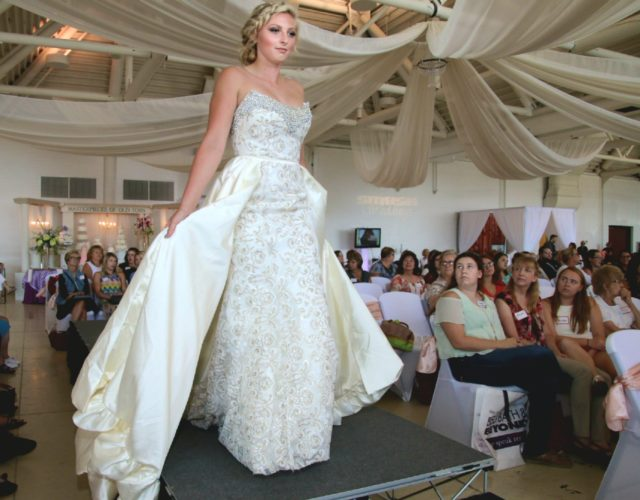 Photo by Joe Lovell Isadora Thompson models a Sorelle Boutique bridal gown at the Brides Brunch and Bands Wedding Show in St. Clairsville.