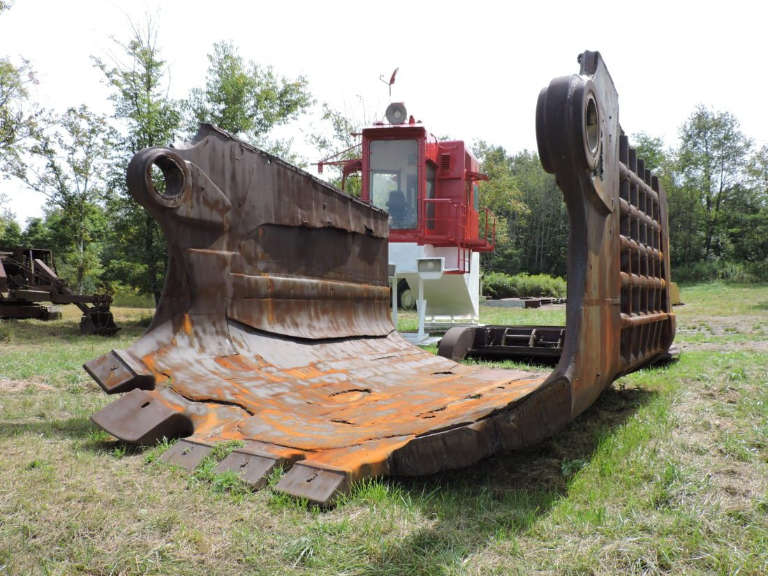 T-L Photo/DYLAN McKENZIE  A massive shovel sits in front of a cab that once controlled it at the Harrison Coal and Reclamation Historical Park. Guests to the annual mining equipment show this weekend will have the chance to learn more about the history of such items.