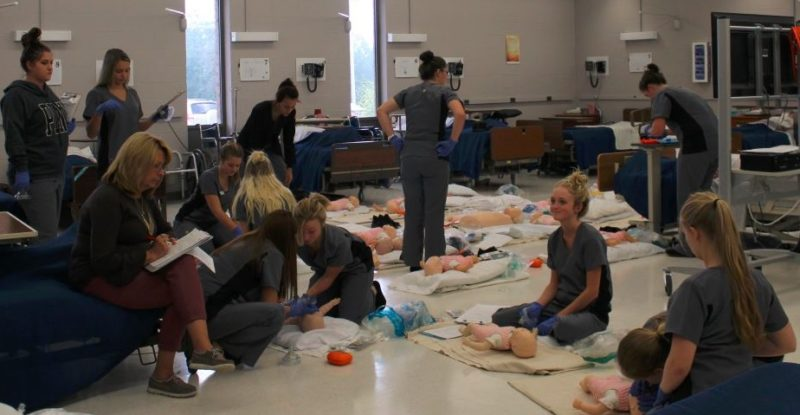 Photo Provided TAMMYSISMONDO, health technologies instructor at Jefferson County Joint Vocational School in Bloomingdale, oversees a class of students in the new lab. The program moved to another room in the building and space was expanded to make way for a classroom, lab with a surgical station, phlebotomy station, medical office and pharmacy.
