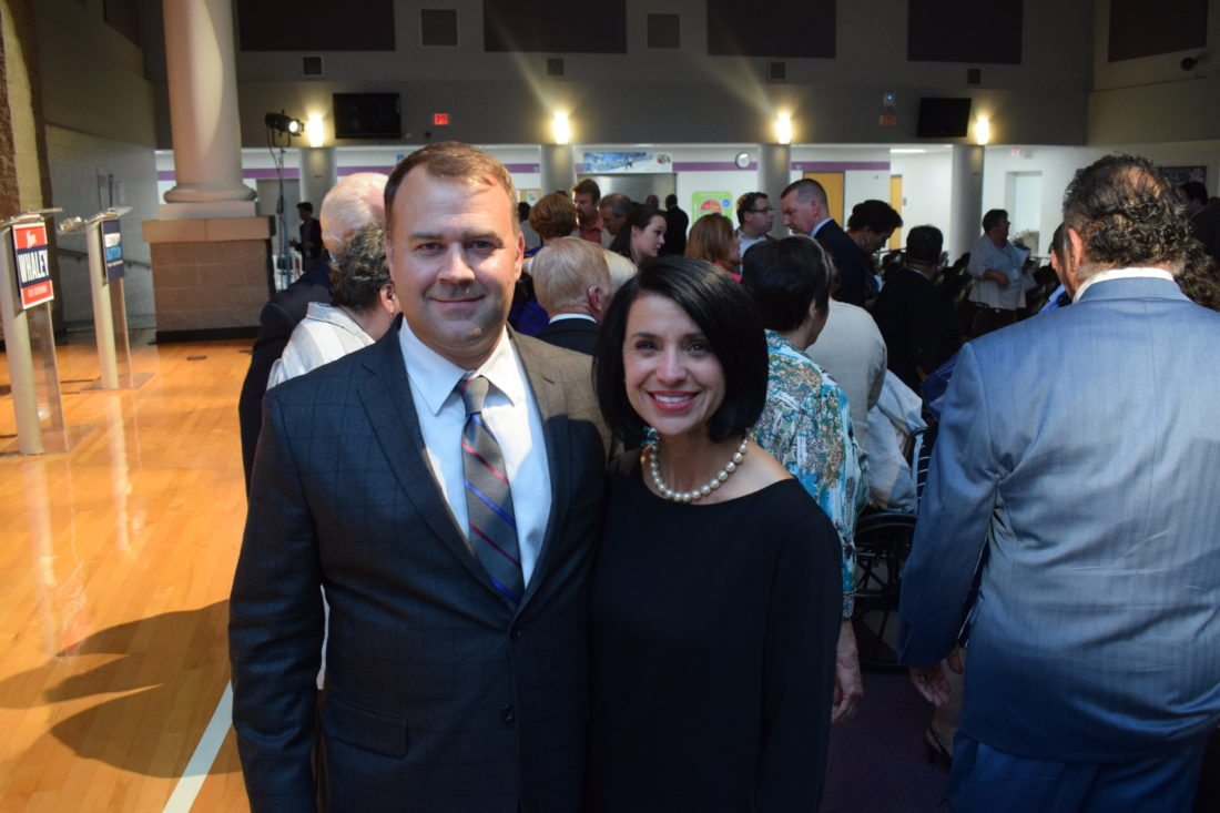Photo by Scott McCloskey Ohio Democratic Party Chairman David Pepper and former Belmont County Commissioner Ginny Favede pose for a photo after Tuesday's debate between the four Democratic candidates for Ohio governor at Martins Ferry High School.