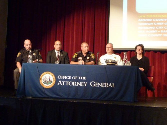"""Panelists for the """"Combating Addiction with Grace"""" conference in Wheeling on Thursday were, from left, Ohio County Sheriff Tom Howard, Drug Enforcement Agency agent Dan Mavromatis, Brooke County Sheriff Larry Palmer, Weirton Police Chief Rob Alexander and Wheeling Councilwoman Wendy Scatterday.   Photos by Linda Comins"""