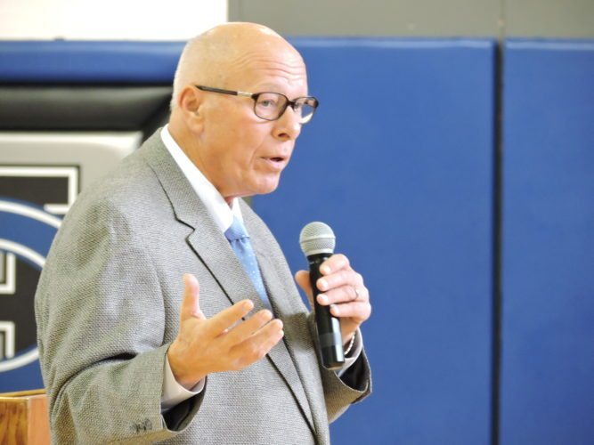 T-L Photo/DYLAN McKENZIE  Ed Rensi speaks to students at Harrison Central High School on Thursday afternoon. Rensi, born in Hopedale, has had a successful career at McDonald's, serving as president and CEO of the company.