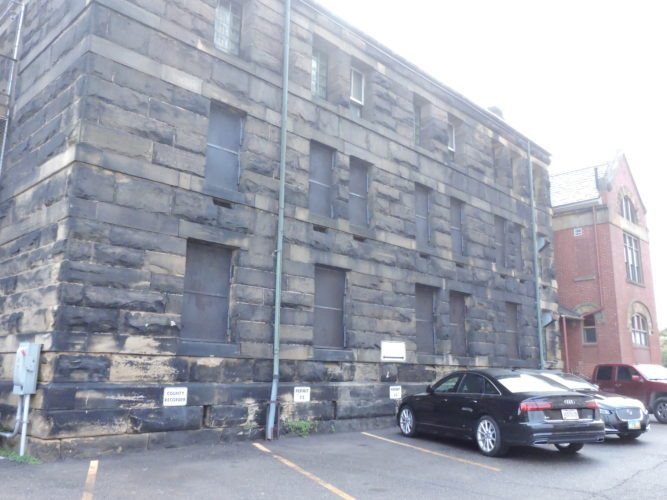 T-L Photo/ROBERT A. DEFRANK The Belmont County Board of Commissioners accepts a bid for the exterior renovation of the former county jail on Friday. Work on the exterior should be completed by the end of the year. The building's interior may then be renovated for future use.