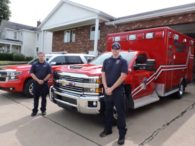 T-L Photo/ROBERT A. DEFRANK ABOVE: Michael Minder. left, and Jeremy Rife are shown with the Cumberland Trail Fire District's new ambulance.