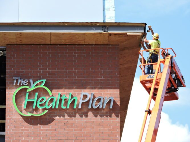 Photo by Casey Junkins ABOVE: Contractors continue work on The Health Plan headquarters, which should open in downtown Wheeling within a few months.