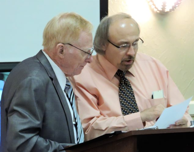Belmont County Auditor Andy Sutak announced his retirement Monday after more than 30 years of service to the county. Here, Sutak speaks with Phil Wallace, president of the Belmont County Democratic Party, which will appoint a new auditor to serve out the rest of Sutak's term.
