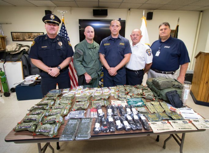 Photo Provided Displaying the specialized medical supplies Wheeling Hospital donated to Wheeling Fire Department's SWAT Medics are, from left: Chief Shawn Schwertfeger of the Wheeling Police Department; Sgt. Jonathan Stipetich, WPD SWAT Team member; Eric Touvelle, WFD firefighter/paramedic and member of the SWAT Medic team; WFD Chief Larry Helms; and John Sebring, Wheeling Hospital director of Safety and Security. The WFD Swat Medics accompany the police SWAT team on tactical missions to provide any needed medical assistance.