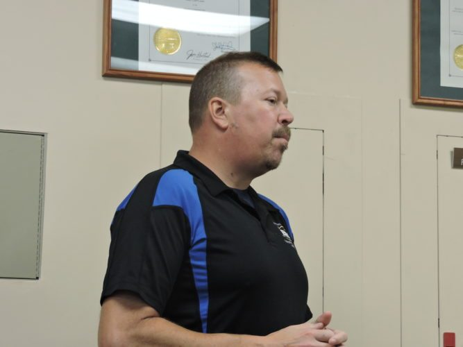 T-L Photo/DYLAN McKENZIE  Eric Wilson, director of the Harrison County Emergency Management Agency, speaks to commissioners Wednesday. Wilson talked about the chemical annex to the county emergency plan, saying that he plans to leave it unchanged for the yearly review.