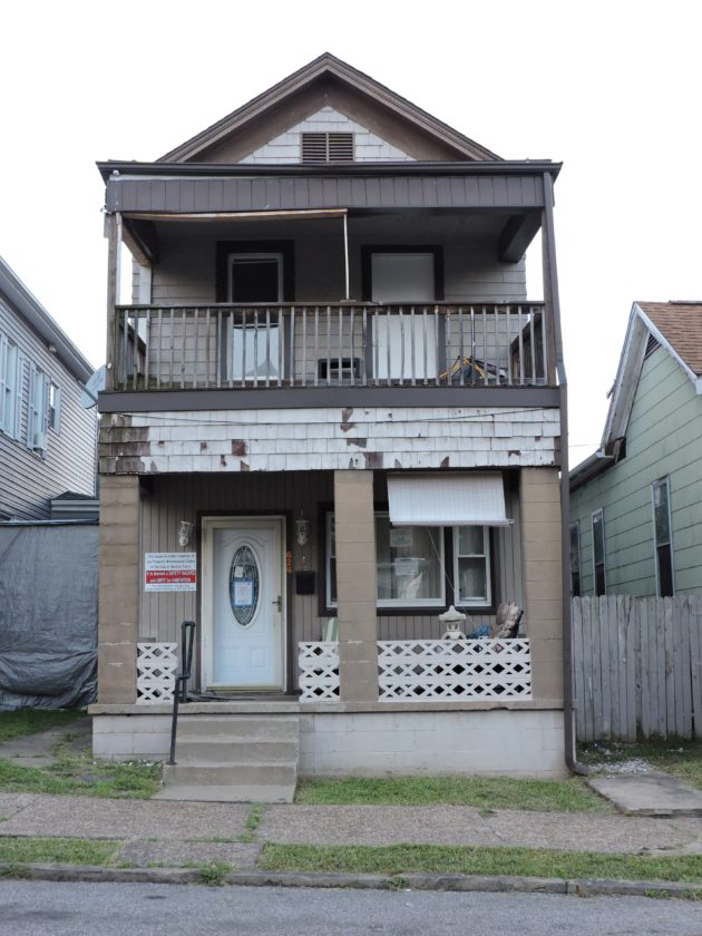 T-L Photo/SHELLEY HANSON TWO WASHINGTON Street residents complained Wednesday about rats coming from this home that has been deemed uninhabitable by the city of Martins Ferry.