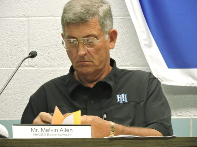 T-L Photo/DYLAN McKENZIE  Harrison Hills Board of Education member Melvin Allen looks over the agenda for Thursday's meeting.