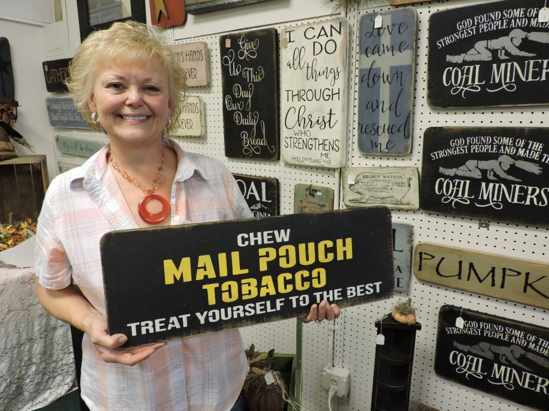 Vicki Bostick, owner of Grandma's Primitives in Barnesville, displays her wares at her new store in the heart of downtown Barnesville.