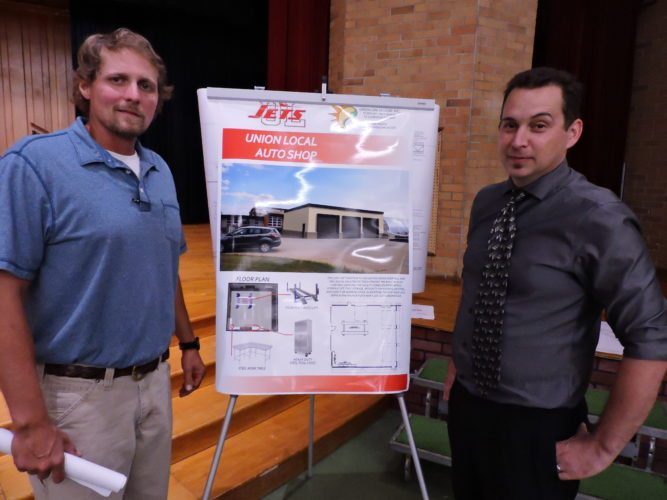 T-L Photo/ ROBERT A. DEFRANK Union Local High School vocational teacher Drew Greenwood and architect Jeremy Greenwood review a proposal for an automobile workshop which could be an option for students next year.