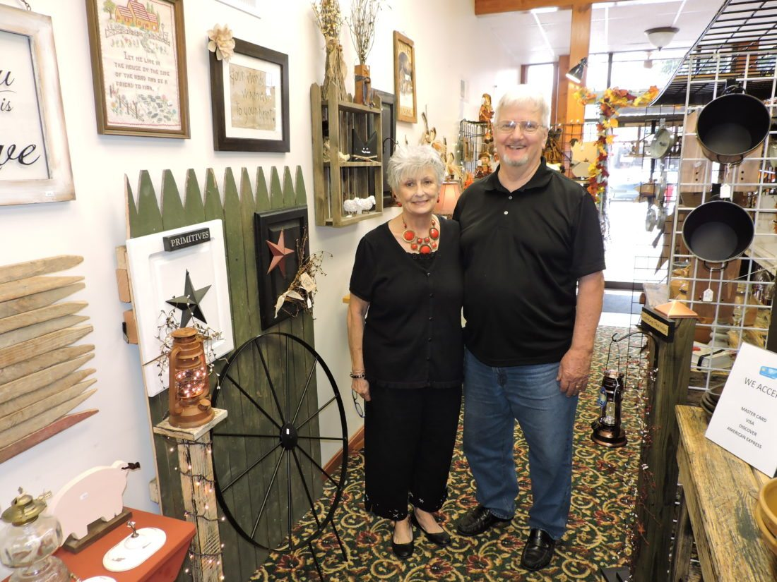T-L Photo/SHELLEY HANSON PAT AND Bill Rice pose inside their Buffalo Creek Primitives shop now located on Belmont Street in Bellaire.