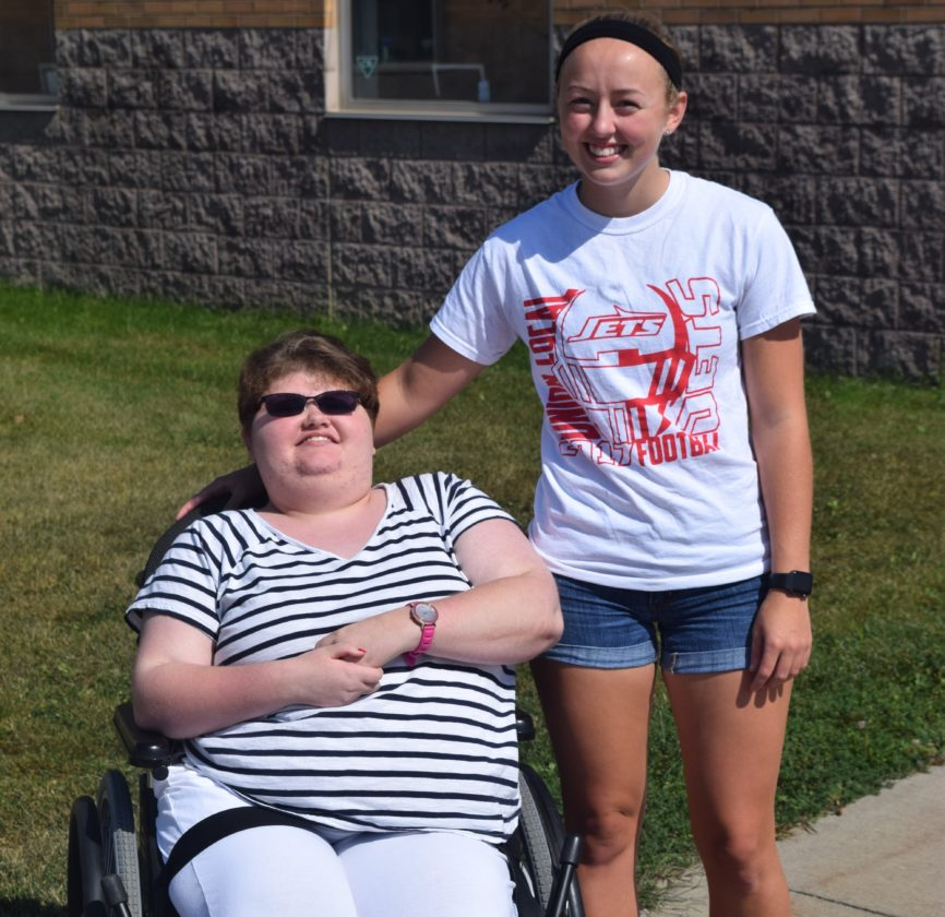 T-L Photo/SETH STASKEY/ UNION LOCAL senior Haley Porter, right, was voted to the school's Homecoming Court, but opted to give up her spot to classmate and friend Cortney Bugala, who has cerebral palsey. Union Localás Homecoming festivities begin this evening with a parade. The queen will be crowned Friday at halftime of the Jets' football game against Weir.
