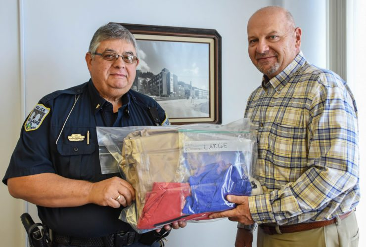 Photo provided BELLAIRE POLICE Chief Mike Kovalyk receives a donation of first responder carfentanyl recovery kits from Belmont Community Hospital CEO John DeBlasis. The kits will be kept in officers' cruisers.  Hospital donates carfentanyl recovery kits to Bellaire police