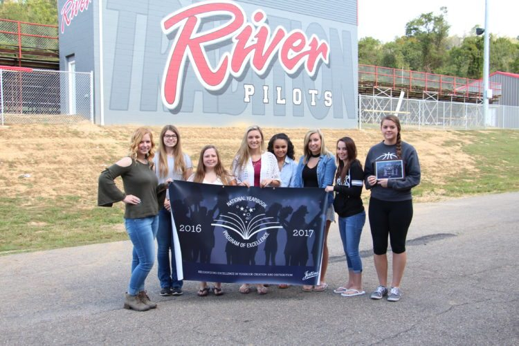 Photo Provided The 2017-18 River High School yearbook staff poses with the National Yearbook Program of Excellence Award that was received for the 2016-17 yearbook. From left are: Olivia Hoskins, Alexis White, Kenzie Stack, Alyson Johnson, Destiny Merrill, Meghan Sullivan, Alexis Kinney and Kirsten Brown.