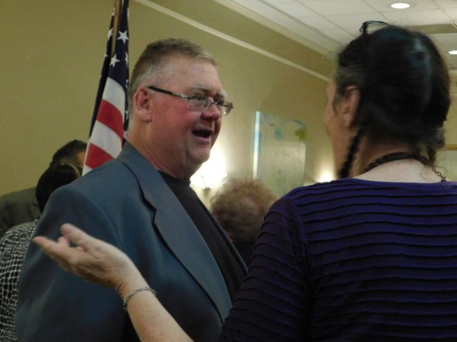 T-L Photo/ ROBERT A. DEFRANK Roger Conroy is appointed Belmont County auditor on Monday during a meeting of the county Democratic Party.